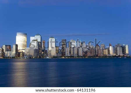 Downtown Manhattan skyline during the blue hour at sunset - stock photo