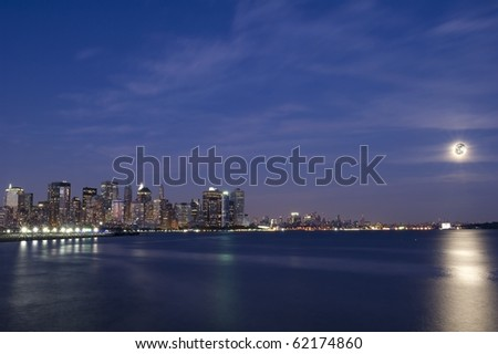 Downtown Manhattan skyline during the blue hour on full moon light