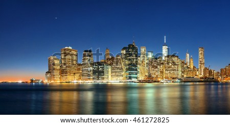 Downtown Manhattan skyline over East River at night in New York City
