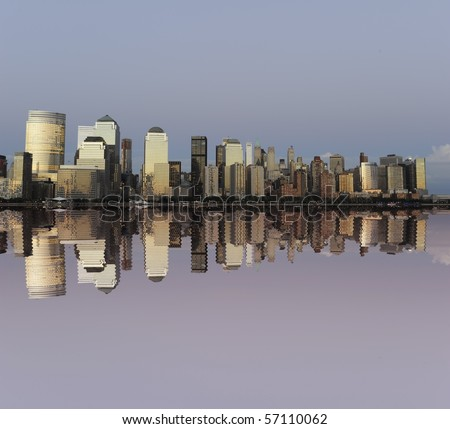 Downtown Manhattan skyline reflecting in the Hudson river - stock photo