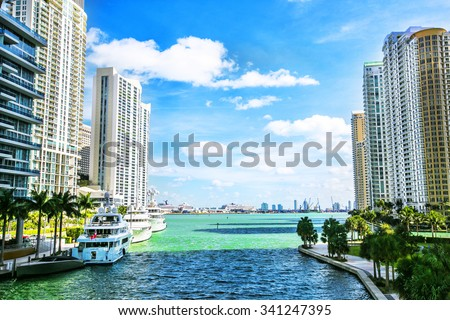 Downtown Miami along the Miami River inlet with Brickell Key in the background - stock photo