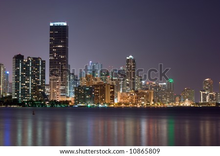 Downtown Miami bayfront, business district and condos at night.