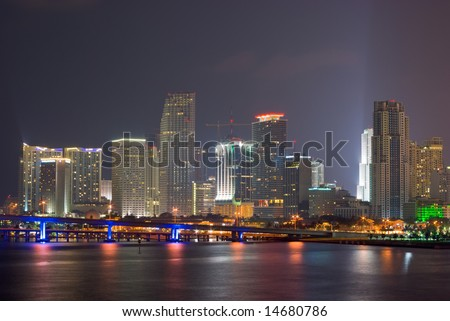 Downtown Miami Bayfront Skyline at Night, Showing Business, Residential and Entertainment Districts - stock photo
