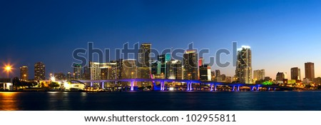 Downtown Miami skyline panorama and Biscayne Bay at dusk - stock photo