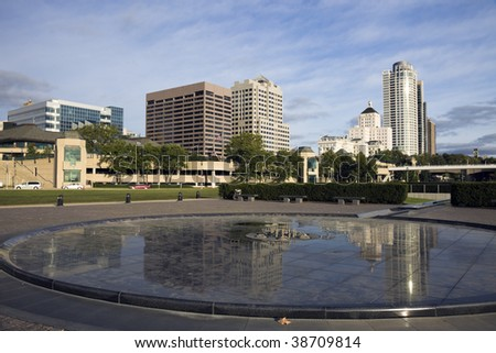 Downtown Milwaukee reflected in fountain. - stock photo