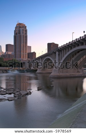 Downtown Minneapolis Minnesota - St Anthony Falls and lock & dam in foreground - stock photo