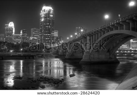 Downtown Minneapolis MN - Black and white - Third Avenue Bridge and St Anthony Falls - stock photo