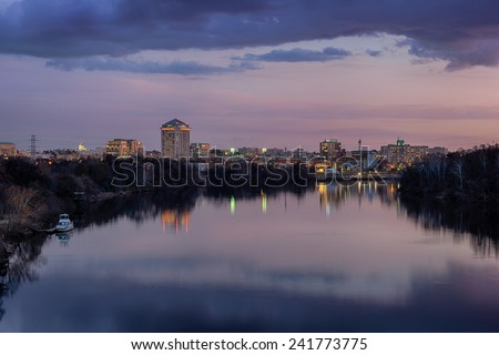Downtown Montgomery and the Alabama River at dusk in Montgomery, Alabama - stock photo