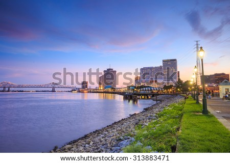 Downtown New Orleans, Louisiana and the Missisippi River at twilight - stock photo