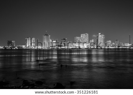 Downtown New Orleans, Louisiana and the Mississippi River at twilight - stock photo