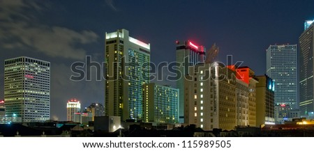 Downtown New Orleans, Louisiana seen at night - stock photo