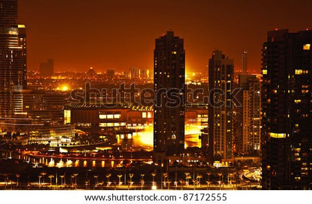 downtown night scene with city lights, luxury new high tech town - stock photo