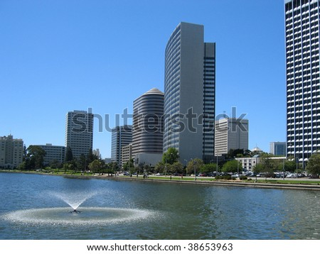 Downtown Oakland from Lake Merritt, with landmark Kaiser Center Building - stock photo