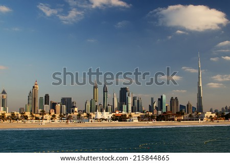 Downtown of Dubai in the evening. Burj Khalifa, the tallest building in the world. Beautiful skyline of modern skyscrapers of the city built in the desert.  The view from the Persian Gulf - stock photo