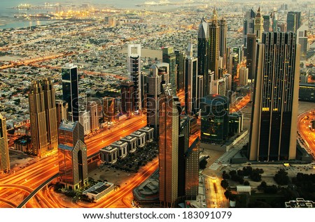 Downtown of Dubai (UAE, United Arab Emirates) at night. View from Burj Khalifa, the tallest building in the world. Downtown Dubai is a large mixed-use complex, important part of development in Dubai.  - stock photo
