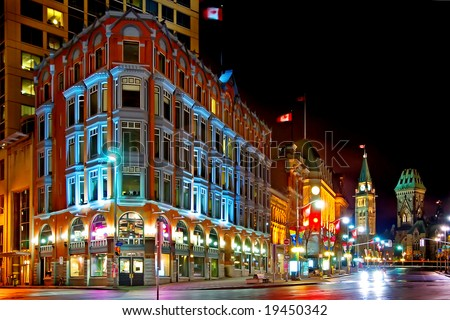 Downtown Ottawa at night.  Shows historic Chambers building and the clock tower of the parliament of Canada - stock photo