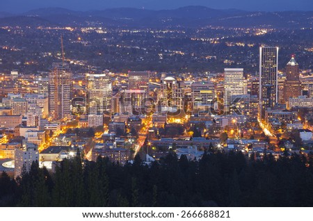 Downtown Portland Oregon city lights blue hour panorama. - stock photo