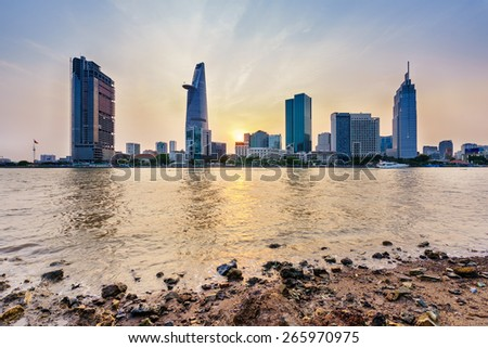 Downtown Saigon in sunset (view from Thu Thiem district), Ho Chi Minh city, Vietnam. Ho Chi Minh city is the biggest city in Vietnam. - stock photo