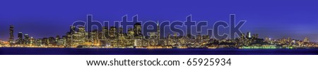 Downtown San Francisco skyline panorama with a blue sky. - stock photo
