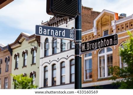 Downtown Savannah, Georgia cityscape with street signs. - stock photo