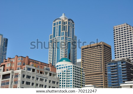 Downtown Seattle in the summer at noon, many styles of buildings.