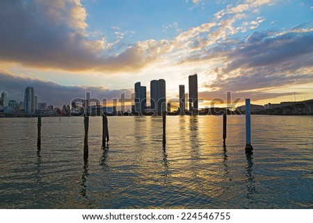 Downtown skyline at sunset with cloudy skies in Miami, Florida. Miami city waterfront at sunset with dramatic sky. - stock photo