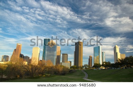 Downtown skyline with turbulent sky - stock photo