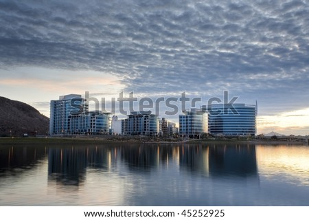 Downtown Tempe office and condo buildings with Tempe Town Lake in the foreground. - stock photo