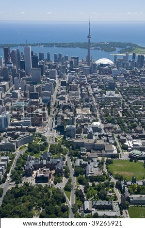 Downtown Toronto, Canada, seen from just above Bloor Street West and Queens Park, looking south towards the Toronto Islands. - stock photo