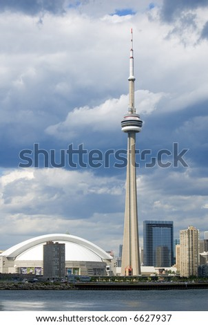 Downtown Toronto - including the Rogers Centre, and CN Tower - just before a summer shower. - stock photo
