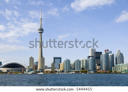 Downtown Toronto - including the Rogers Centre, CN Tower, and banking district - in late summer. - stock photo