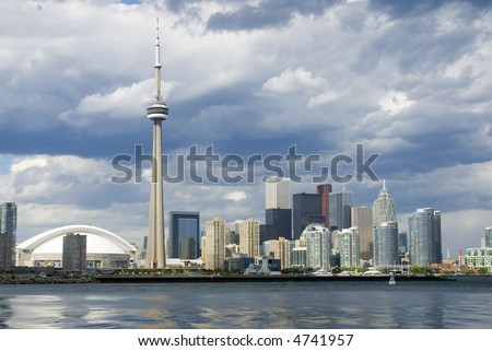 Downtown Toronto - including the Rogers Centre, CN Tower, and banking district - just before a summer shower. - stock photo