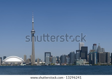 Downtown Toronto - including the Rogers Centre, CN Tower, and the banking district - in early summer. - stock photo