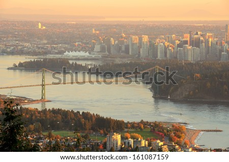 Downtown Vancouver and Lions Gate Bridge at sunset, viewed from Cypress Mountain lookout - stock photo