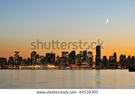 downtown vancouver night scene with crescent moon - stock photo