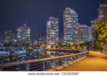 Downtown Vancouver skyline at night - stock photo