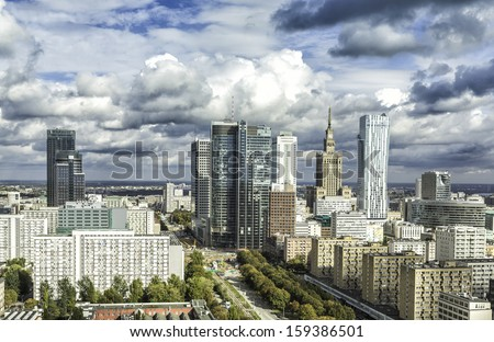 Downtown Warsaw at sunny autumn afternoon with dramatic clouds, Poland - stock photo