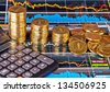 Downtrend stacks of golden coins, calculator and financial chart as background. Selective focus - stock photo