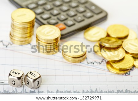 Downtrend stacks of golden coins, dices cubes with the words SELL BUY,  calculator on the financial stock charts. Selective focus - stock photo