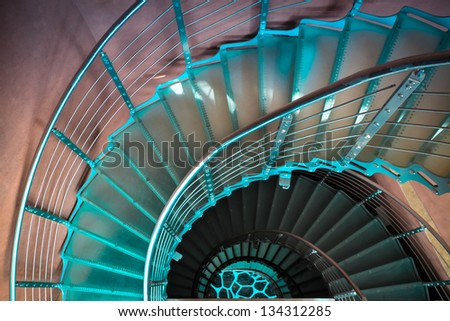 downward spiraling staircase in a  modern tower - stock photo