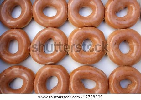 Dozen Glazed Donuts in Box - stock photo