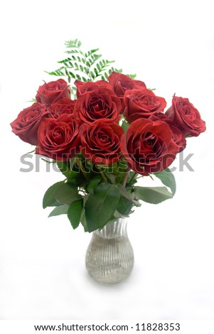 Dozen red roses in a vase on a white background - stock photo