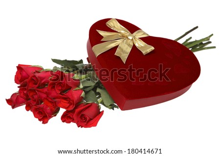 dozen red roses with chocolate heart shaped box with gold bow on white background