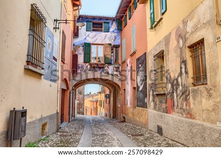 DOZZA, ITALY - FEBRUARY 28: wall with paintings in town where every two years takes place a festival and famous artists paint on the walls of the houses. February 28, 2015 in Dozza, Bologna, Italy  - stock photo