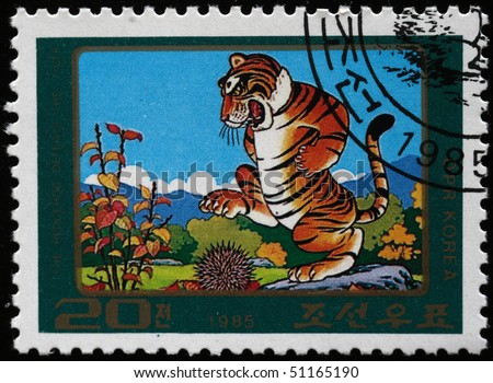 "DPR KOREA - CIRCA 1985: A stamp is printed in the Democratic People's Republic of Korea (North Korea) depicts an illustration of the folk tale ""The hedgelhog defeats the Tiger"", circa 1985"