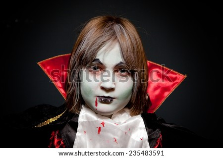 Dracula, child dressed up as vampire for halloween. seasonal celebration of horror when children go trick and treat - stock photo