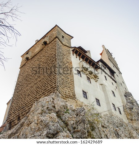 Dracula's Castle  on the top of the rock (Bran Castle), a famous castle of the Count Vlad Tepes, Bran, Romania. Home of the Vampire Dracula, the Bram Stoker's novel character. - stock photo