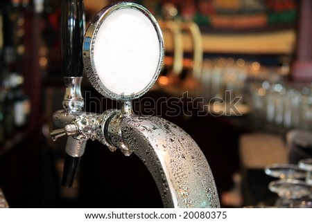 Draft beer tap covered in condensation water droplets - stock photo