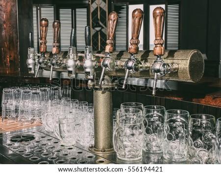 Draft Beer Taps In Modern Bar
