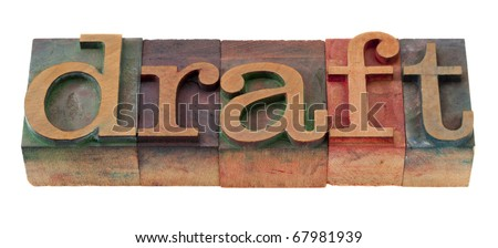 draft  word in vintage wooden letterpress printing blocks, stained by color inks, isolated on white